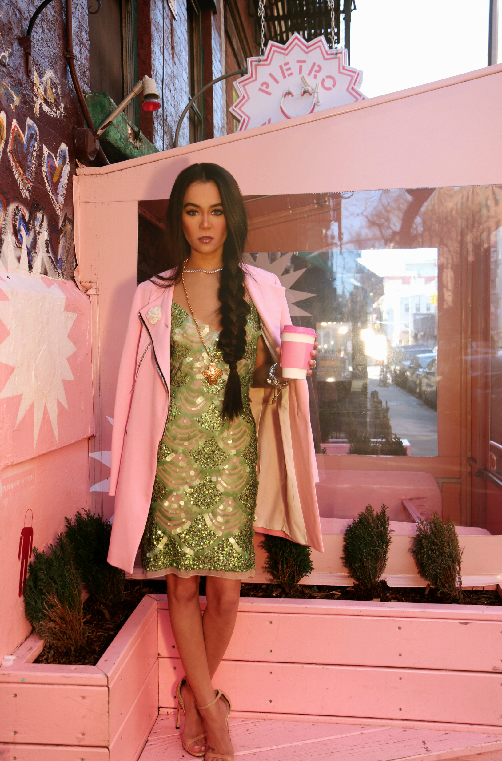 NYC Style Blogger Annamaria Stewart wearing a vintage mint green sequin paillette midi dress, millenniall pink long moto coat from Zara, vintage 90's gold chain necklace, and a diamond bracelet stack, pink coffee cup, Pietro Nolita