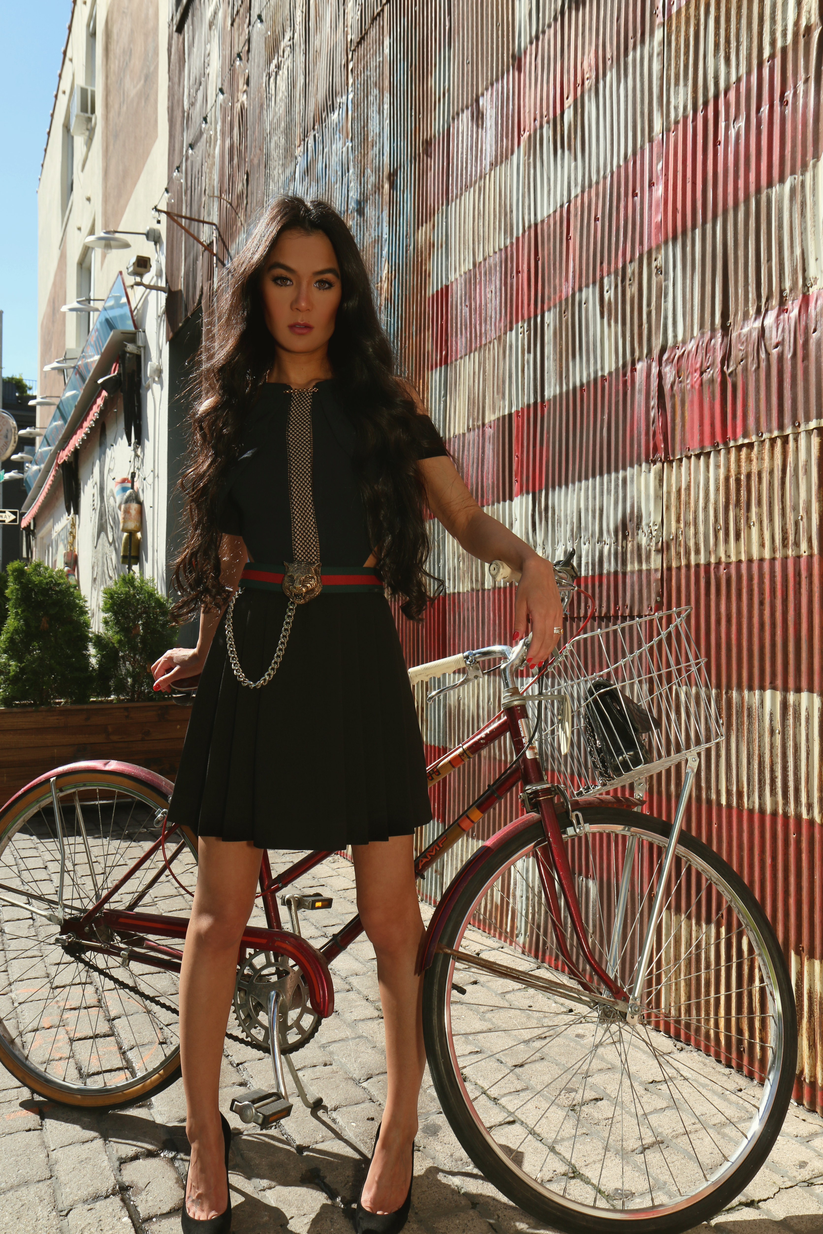 NYC Style Blogger Annamaria Stewart wearing Self-Portrait Chained-Up mesh-paneled crepe mini dress, Gucci feline buckle web belt, and Stuart Weitzman black suede Heist pumps, pictured at Shelter Pizza in Williamsburg Brooklyn, with a vintage 1970's bike - The Shopping Patch