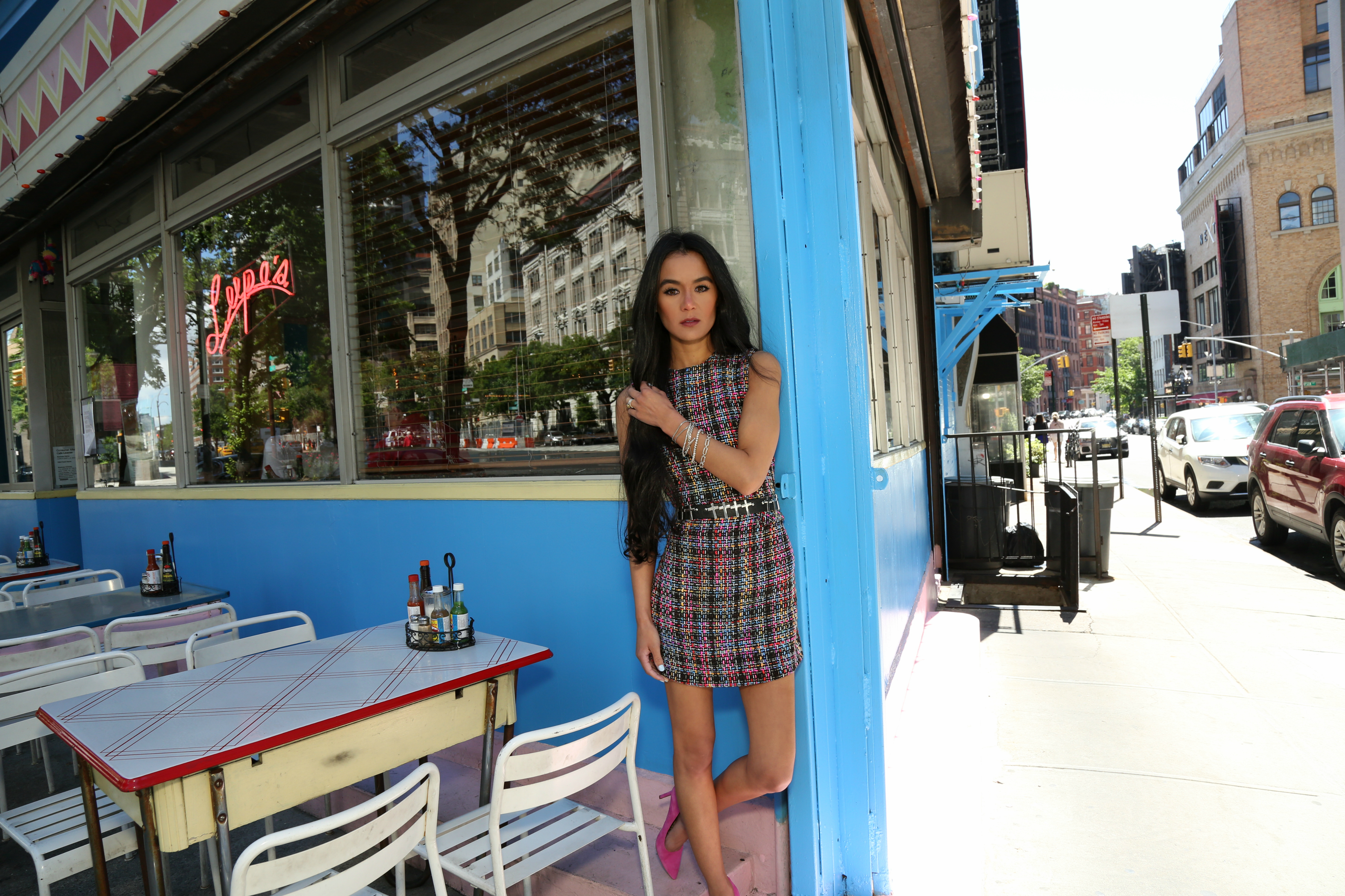 NYC Style Blogger Annamaria Stewart wearing a rainbow tweed mini dress, Forever 21 punk cross leather belt, Rachel Roy fringe shoulder sweater, and Sam Edelman Hazel Pump in Hot pink suede, pictured at Lupe's East L.A. Kitchen in SoHo, NYC - The Shopping Patch